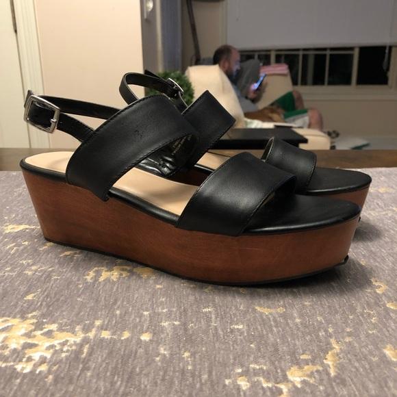 black wooden platform sandals